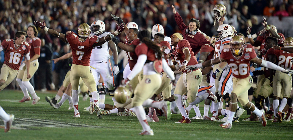 Description of . Florida State rushes the field after defeating Auburn 34-31 during the BCS National Championship game at the Rose Bowl in Pasadena, Calif., on Monday, Jan. 6, 2014. 