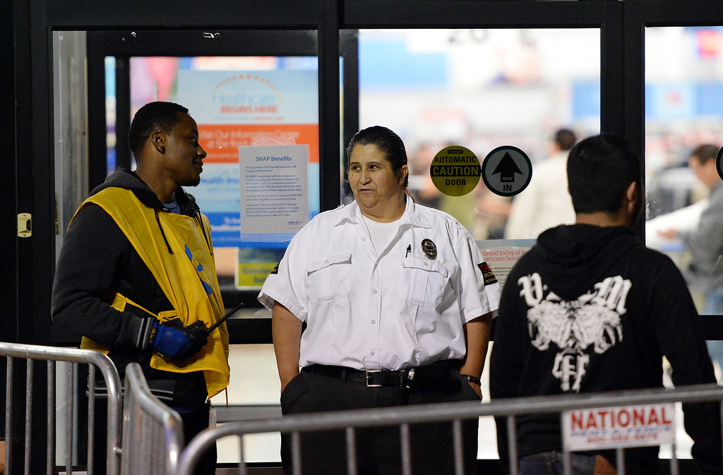 Description of . Police officers descended on Walmart in Rialto after a brawl between two men injured a police officer who tried to break up the fight Thursday night. The injured officer was transported to St. Bernardine Medical Center in San Bernardino with a broken wrist, police officials said. A Walmart manager said the doors were originally scheduled to open at 8 p.m. but with the more than 3,000 people in line they made the decision to open the doors early, which police said led to the melee. Police said there were three fights total shortly after 7 p.m. at the store at 1610 S. Riverside Ave., two of which were inside over merchandise and the third outside that caused injury to the officer. (Will Lester/Inland Valley Daily Bulletin)