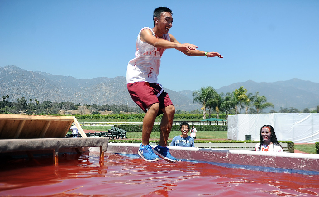 Description of . Seventeen year-old Calvin Khuat of Rosemead leaps into the pool of blood during the Zombie Blood Run at Santa Anita Park on Saturday, Aug. 17, 2013 in Arcadia, Calif. The American Red Cross San Gabriel Pomona Valley chapter is partnering with the Zombie Blood Run to prepare the San Gabriel Valley for a disaster, even a zombie apocalypse.  (Keith Birmingham/Pasadena Star-News)