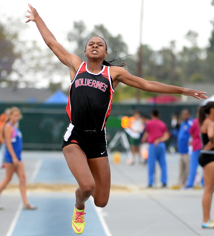 Description of . Harvard Westlake's Courtney Corrin competes in the Division 3 long jump during the CIF Southern Section track and final Championships at Cerritos College in Norwalk, Calif., on Saturday, May 24, 2014. 