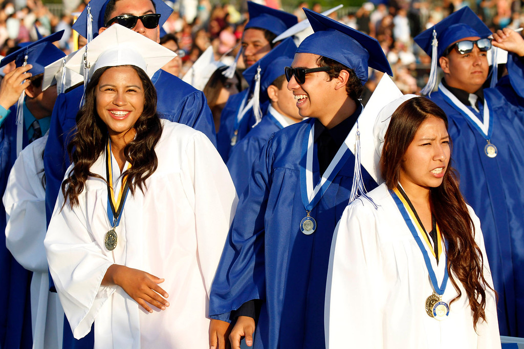 Description of . Jubilant graduates during the El Monte High School Class of 2014 Commencement Ceremony, at El Monte High School's Football Stadium in El Monte, CA., Wednesday, June 11, 2014.  (Photo by James Carbone for the San Gabriel Valley Tribune)