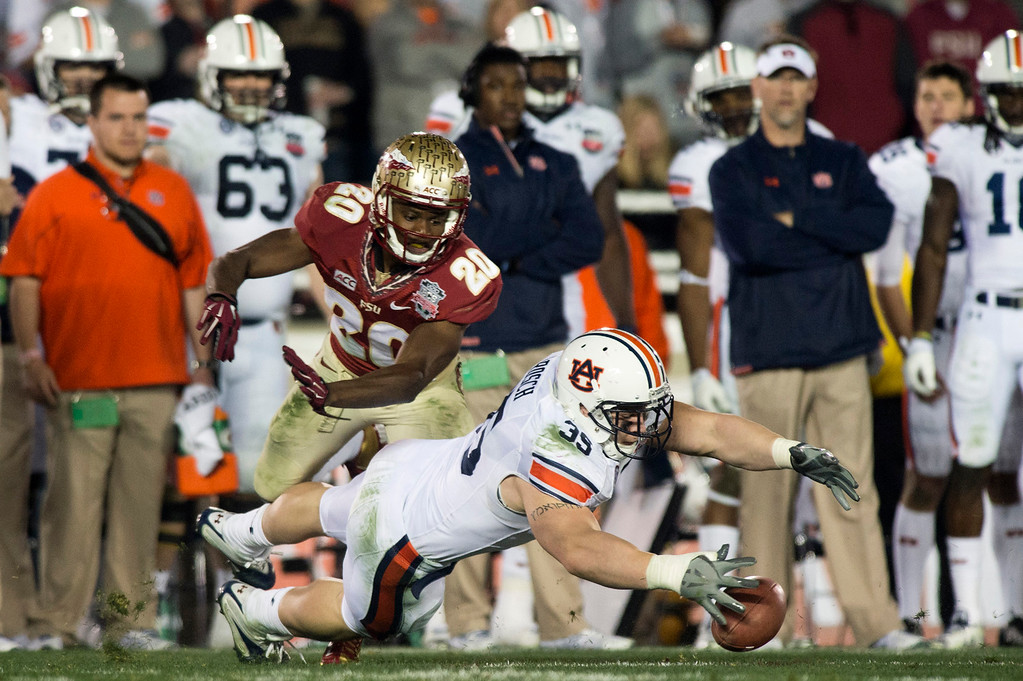 Description of . Auburn's Jay Prosch (35) dives for the ball over Florida's mack VanGorder (20) in the scond half of the BCS National Championship game at the Rose Bowl in Pasadena Calif. on Monday, Jan. 6, 2014. (Watchara Phomicinda/ Pasadena Star-News)