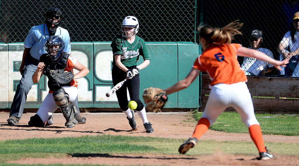 Description of . Westridge's Grace Wallis grounds out to Poly starting pitcher DeeDee Logan (6) in the fourth inning of a prep softball game at Westridge High School in Pasadena, Ca on Tuesday, April 15, 2014. Poly won 11-1. (Keith Birmingham Pasadena Star-News)
