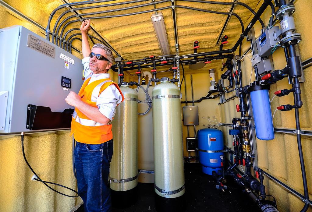 Description of . PG&E Environmental Engineer Kevin Sullivan discusses the whole house water filtration process inside a unit in Hinkley, Calif. on Thursday, May 2, 2013. Sullivan leads the company's Hinkley remediation program. (Rachel Luna / San Bernardino Sun)