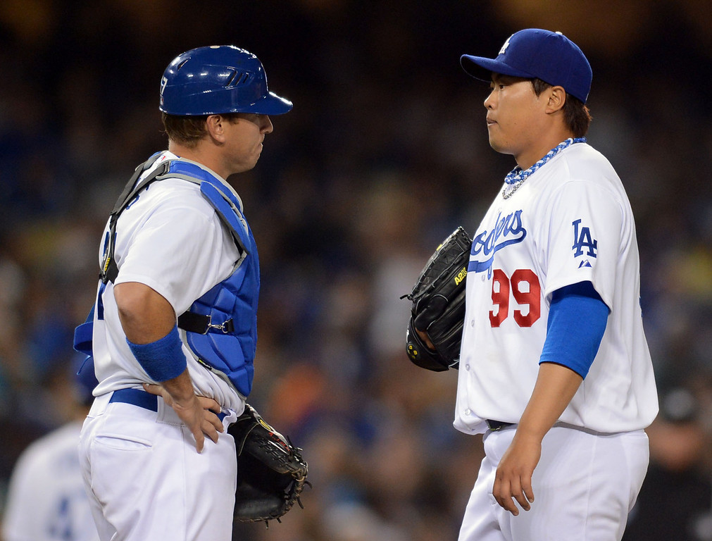 Description of . Dodger catcher A.J Ellis talks with pitcher Hyun-Jin Ryu before he was taken out of the game against the Giants Dodger Stadium April 2, 2013.  The Giants defeated the Dodgers 3-0 Tuesday night.(Andy Holzman/Los Angeles Daily News)