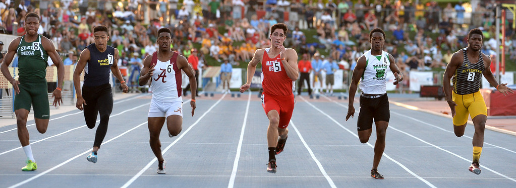 Description of . Mater Dei's Curtis Godin, center, between Alemany's Dominic Davis, left, and Monrovia's Cravon Gillespie, right, wins the 100 meter dash during the CIF California State Track & Field Championships at Veteran's Memorial Stadium on the campus of Buchanan High School in Clovis, Calif., on Saturday, June 7, 2014. 