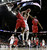 Wisconsin forward Sam Dekker (15) puts up a shot between Mississippi forward Murphy Holloway (31) and  guard Ladarius White (10) during the first half of a second-round game of the NCAA college basketball tournament Friday, March 22, 2013, in Kansas City, Mo. (AP Photo/Charlie Riedel)