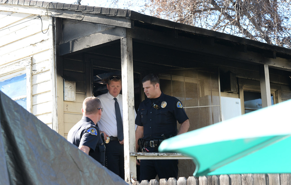 Description of . Whittier Police officers and lead Detective Chad Hoeppner, center, investigate a house fire on the 13500-block of Via Del Palma in Whittier Where two residents were found dead inside on Thursday January 2, 2014. (Staff Photo by Keith Durflinger/Whittier Daily News)