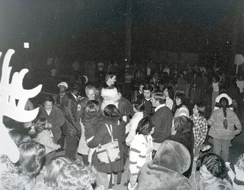 Description of . SAN BERNARDINO -- The Ho Ho Parade was a big deal during the holidays, with its roots traced back to the 1950s. Photos like these through the years show a first-responder community in San Bernardino annually bringing Christmas cheer to the city's neighborhoods. The event was canceled this year. (Courtesy)