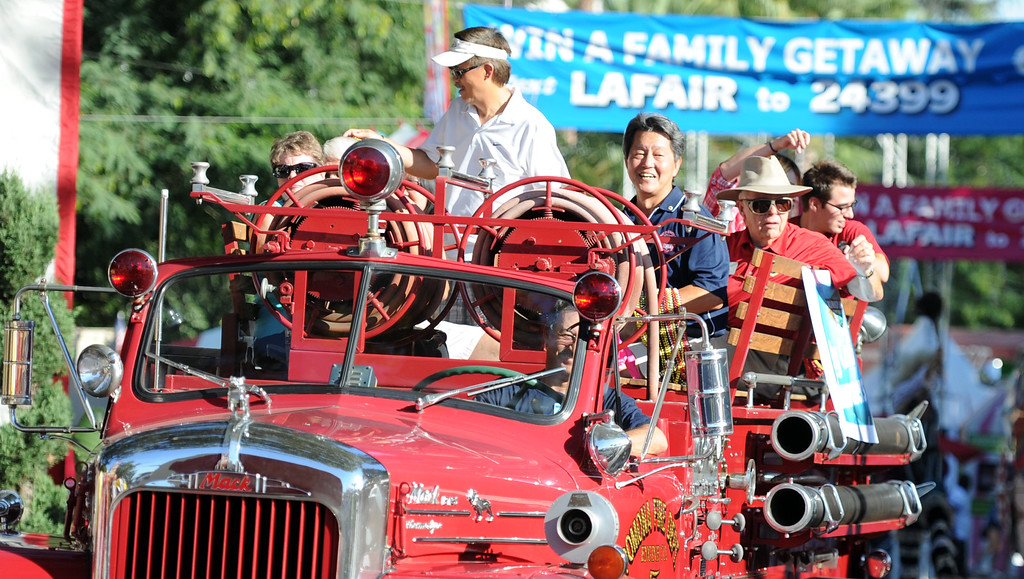Description of . A vintage fire truck during the Diamond Bar community parade during the 91st Annual L.A. County Fair in Pomona, Calif. on Thursday, Sept. 5, 2013.   (Photo by Keith Birmingham/Pasadena Star-News)
