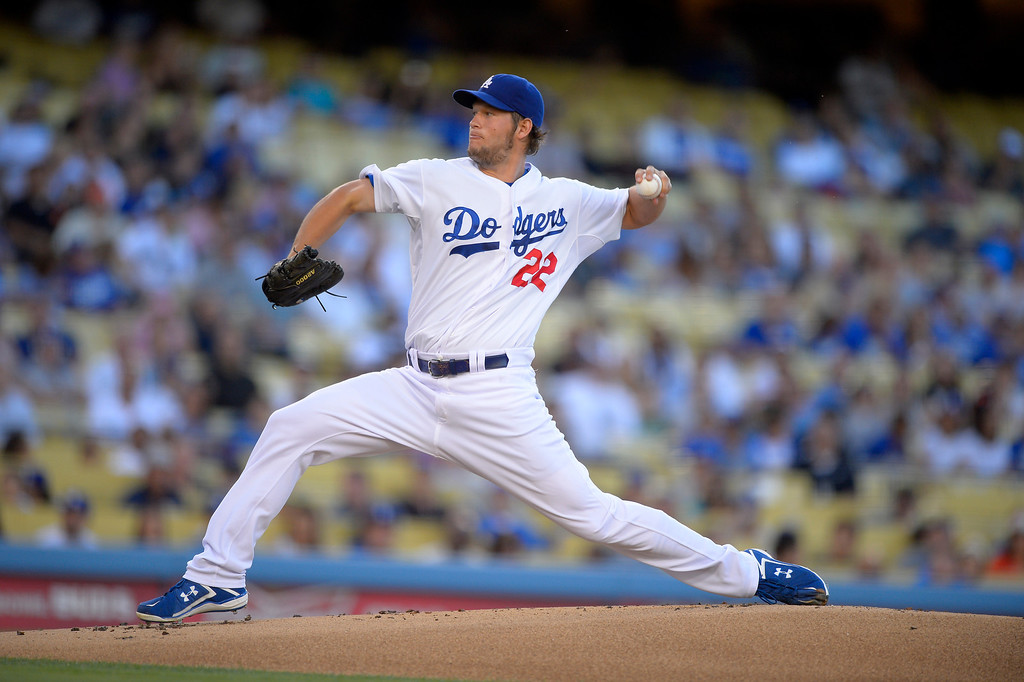 Description of . Los Angeles Dodgers starting pitcher Clayton Kershaw throws to the plate during the first inning of their baseball game against the San Francisco Giants, Wednesday, June 26, 2013, in Los Angeles.  Dodgers won 4-2.   (AP Photo/Mark J. Terrill)