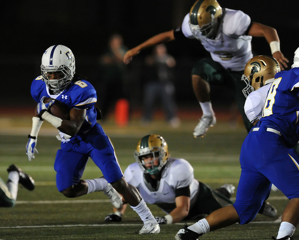 Description of . Charter Oak's Zion Echols (6) runs for a first down in the first half of a prep football game against Damien at Charter Oak High School in Covina, Calif., Friday, Oct. 11, 2013.    (Keith Birmingham Pasadena Star-News)
