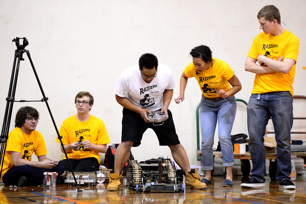 Description of . Richie Hernandez, center, of the Avengers, works the Hulk out of a rut while the 40 Pc Chicken McNuggets team stands by as teams of mechanical engineering Caltech students compete in the annual ME72 Engineering Design Contest at the Pasadena campus Tuesday, March 11, 2014. The goal in