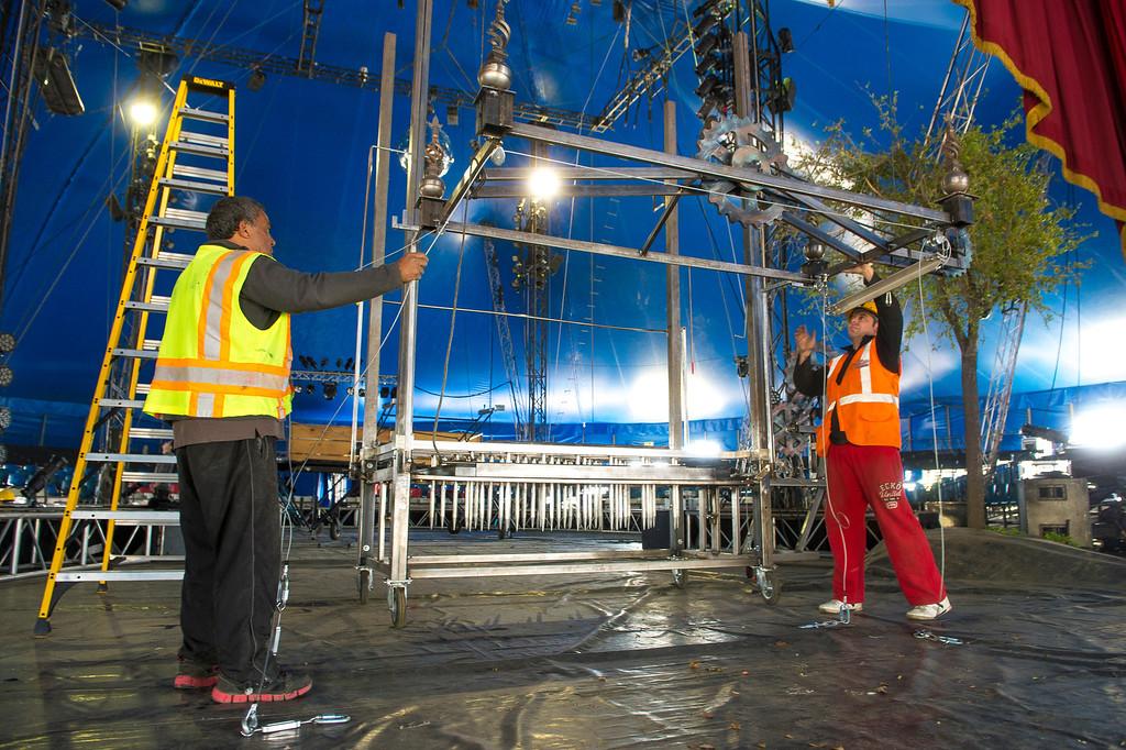Description of . Circus Vargas crew members set up the