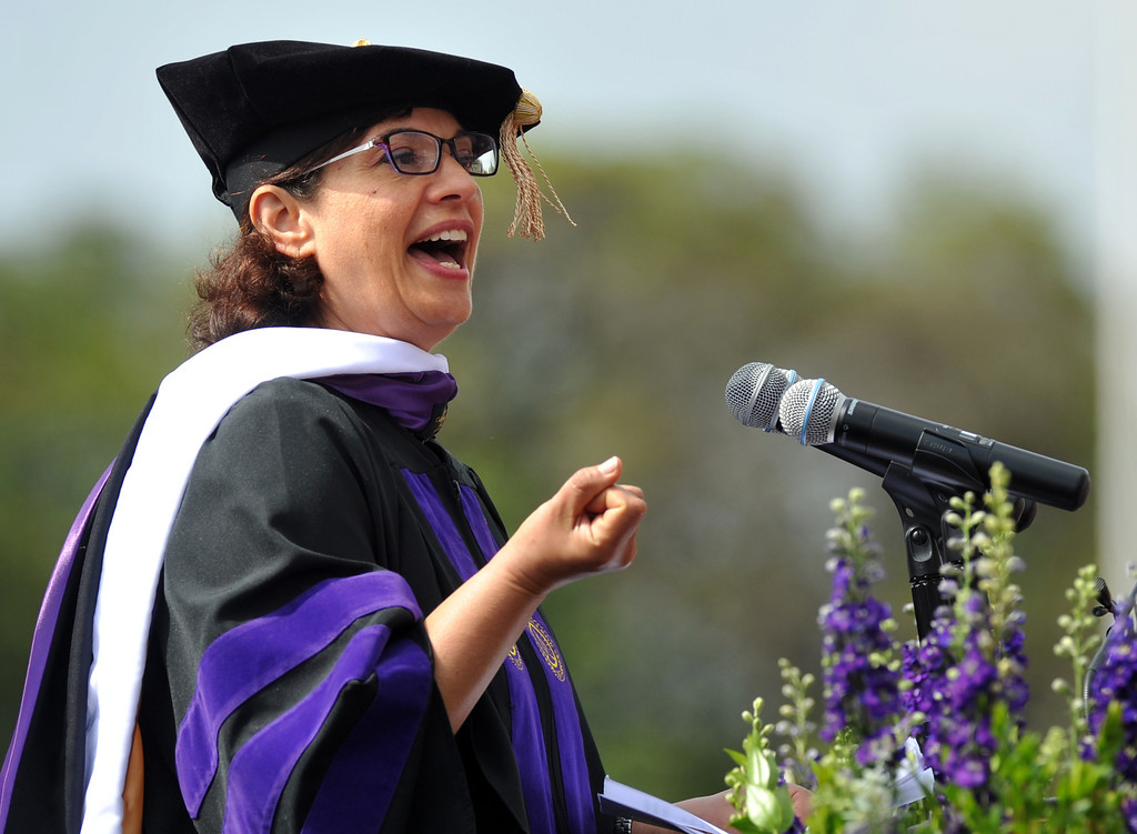Description of . Commencement Speaker, Sonia Nazario, speaks during the 110th Commencement Ceremony at Memorial Stadium on the Whittier College campus in Whittier on Friday May 17, 2013. Award-winning journalist Sonia Nazario gave the keynote address and received an honorary degree from the Whittier College faculty: a doctorate of humane letters.(SGVN/Staff Photo by Keith Durflinger)