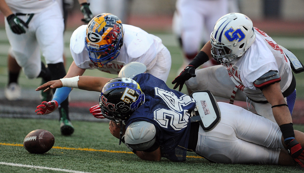 Description of . West's Roger Lemus (24) (Lincoln)  reaches for a loose ball in the first half of the annual East vs. West San Gabriel Valley Hall of Fame all-star football game at West Covina High School on Friday, May 17, 2013 in West Covina, Calif. 