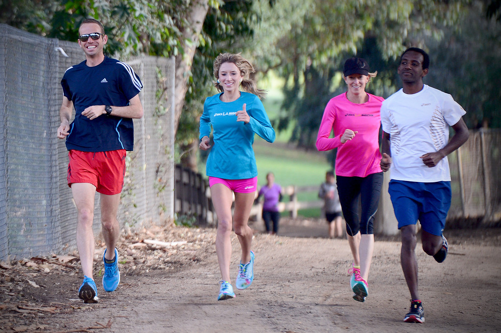 Description of . From left, Aaron Braun, Lauren Kleppin, Deena Kastor and Gabe Proctor train for Sunday's LA Marathon before a group of elite marathon runners met with students, of the Students Run LA program, at Griffith Park in Los Angeles Friday, March 7, 2014. (Photo by Sarah Reingewirtz/Pasadena Star-News)