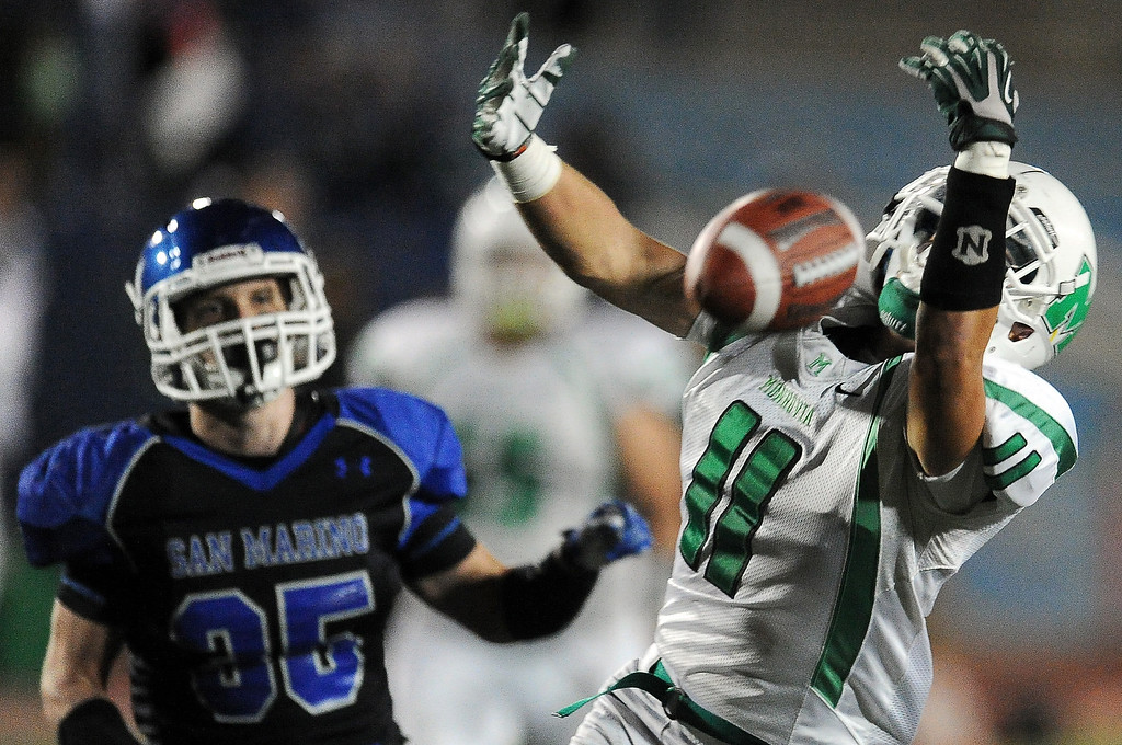 Description of . Monrovia's Logan Craig (11) can't hold onto a pass in the end zone against San Marino in the first half of a prep football game at Monrovia High School in Monrovia, Calif., on Friday, Nov. 8, 2013. 