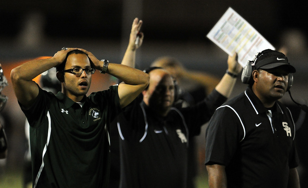 Description of . South Hills coaching staff reacts after Alex Garcia (not pictured) touchdown catch was ruled no touchdown in the first half of a prep football game against Bonita at Covina District Field in Covina, Calif. on Friday, Sept. 6, 2013.   (Photo by Keith Birmingham/Pasadena Star-News)