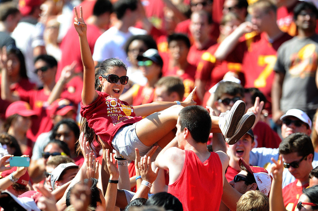 Description of . Southern California fans react after a touchdown against Boston College during the second half of an NCAA college football game in the Los Angeles Memorial Coliseum in Los Angeles, on Saturday, Sept. 14, 2013. Southern California won 35-7. 