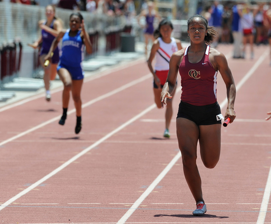 Description of . Ayzha Aupin from Oaks Christian, crosses the finish line as the anchor leg in the Girls 4X100 Meter Relay in the 2013 CIF Southern Section Track & Field Divisional Finals held at Mt. San Antonio College in Walnut, CA 5/18/2013(John McCoy/LA Daily News)