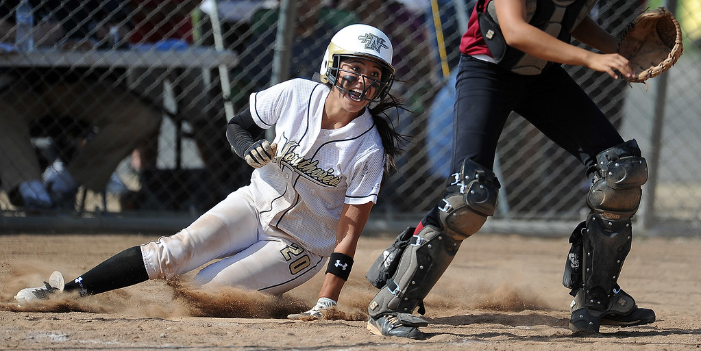 Description of . Northview's Sarina Jaramillo (C) (20) scores in the fourth inning of a CIF-SS quarterfinal playoff softball game against Barstow at Northview High School on Thursday, May 23, 2013 in Covina, Calif. Northview won 5-4.  (Keith Birmingham Pasadena Star-News)