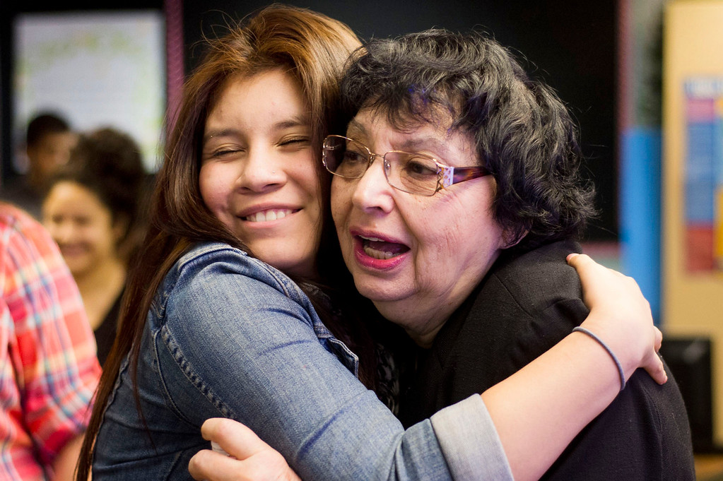 Description of . Inge Auerbacher, 78, one of the Holocaust child survivors, gets a hug from a student after she shared her stories at Sierra High School in Glendora on Tuesday, Nov. 12, 2013. Auerbacher told her stories about the time she spent in the Terezin concentration camp. (Photo by Watchara Phomicinda/San Gabriel Valley Tribune)
