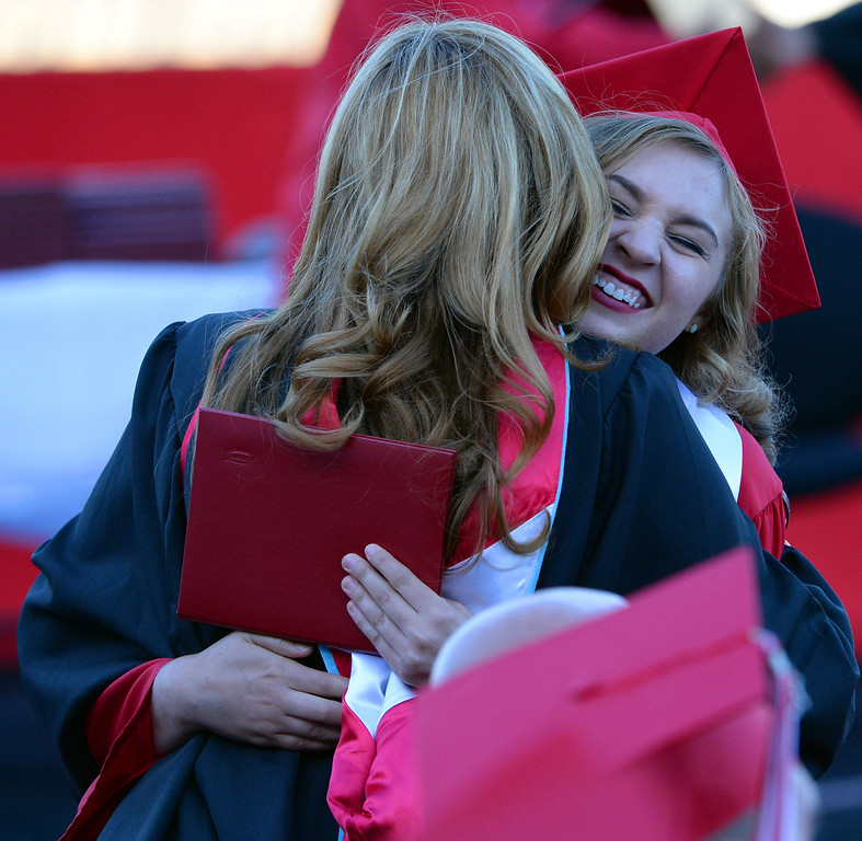 Description of . A graduate hugs Principal Lori Eshilian after receiving her diploma during the Whittier High School graduation at Whittier College in Whittier, Calif., on Wednesday, June 4, 2014.  (Keith Birmingham/Pasadena Star-News)