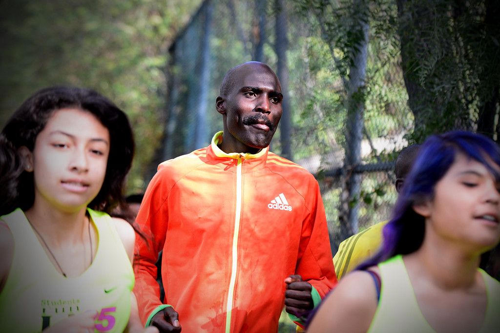 Description of . Elite marathon runner Laban Moiben, who is the 2008 LA Marathon champion, joins students, of the Students Run LA program, for a short run as elite athletes train at Griffith Park in Los Angeles Friday, March 7, 2014 for the LA Marathon. The students will also be running Sunday's marathon. (Photo by Sarah Reingewirtz/Pasadena Star-News)