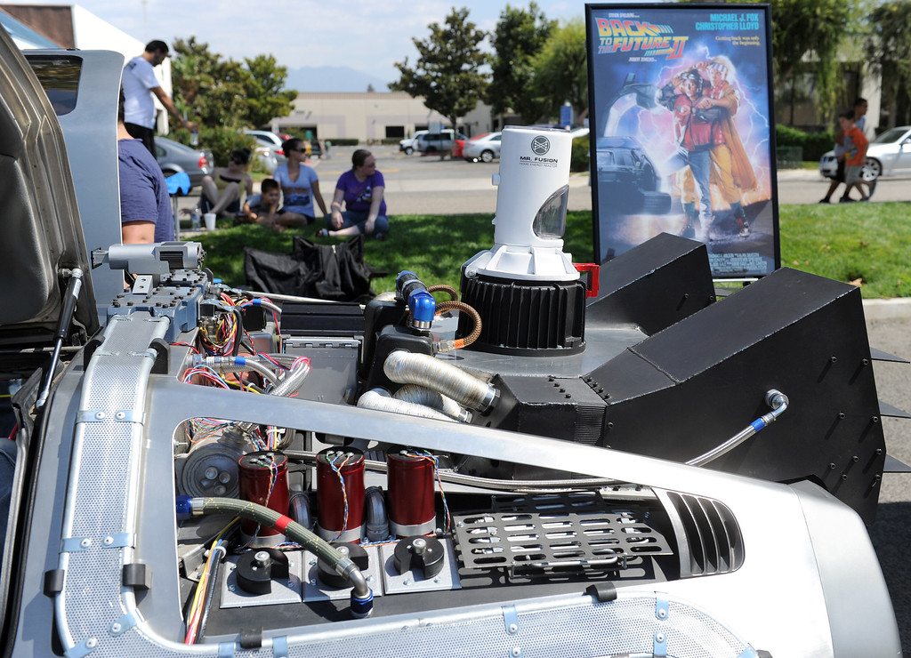 """Description of . Superbad Action Figures in Redlands celebrated the popular film series """"Back to the Future"""" with an event on Saturday. Replica's of the Delorean time machines were on display, Kevin Pike, a special effects supervisor from the film, was there signing autographs for fans.  Replica cars from """"Jurassic Park"""" and """"K.I.T.T."""" from the Knight Rider television series were also on display. (John Valenzuela/Staff Photographer)"""