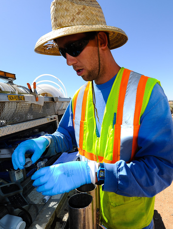 Description of . Eric Randell, a PG&E groundwater sampling tech, collects water from PG&E's testing wells in Hinkley, Calif. on Thursday, May 2, 2013. PG&E and the Lahontan Regional Water Quality Water Board developed remediation actions to clean and contain the chromium-6 groundwater plume below Hinkley. (Rachel Luna / San Bernardino Sun)
