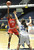02-27-2012--(LANG Staff Photo by Sean Hiller)- Serra vs. Windward in Wednesday's girls basketball CIF SS Div. 4AA title game at the Anaheim Convention Center Arena in Anaheim. Serra's Siera Thompson (3) battles Windward's Emily Surloff (32).