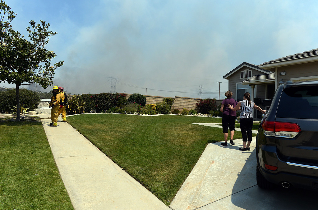 Description of . Residents evacuate as firefighters watch the progress of the Etiwanda Fire Wednesday in Rancho Cucamonga. Over 1,000 acres and over a 1,000 homes are under mandatory evacuation as the Etiwanda Fire burns in Rancho Cucamonga Wednesday April 30, 2014. Cause of the fire is unknown and is burning in areas which burned during the Grand Prix Fire in October 2003. (Will Lester/Inland Valley Daily Bulletin)
