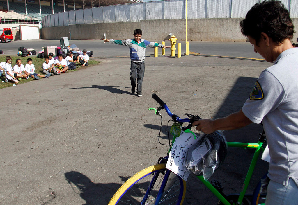 Description of . IDB-L-Pom-Campout-01 (Correspondent Photo by James Carbone) Isaiah Granado, 10, wins a Fixie bike, during the 2013 GREAT Camp Out, at the Park Square area at the Pomona Fairplex, in Pomona, Saturday, July 13, 2013. The Event organized by the Pomona Police Department provides an opportunity for kids to interact with police officers in a positive environment.