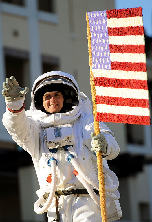 Description of . An actor depicting Neil Armstrong was included with the Wells Fargo's float during the 2014 Rose Parade in Pasadena, CA January 1, 2014.(Andy Holzman/Los Angeles Daily News)