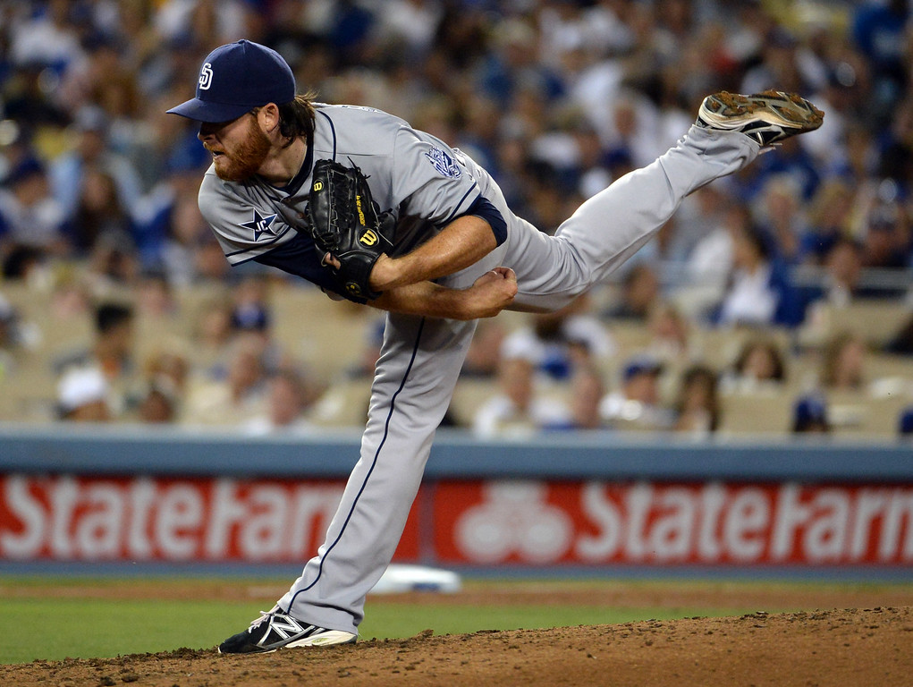 Description of . San Diego Padres starting pitcher Ian Kennedy throws to the plate against the Los Angeles Dodgers in the seventh inning of a Major league baseball game on Saturday, July 12, 2014 in Los Angeles.   (Keith Birmingham/Pasadena Star-News)
