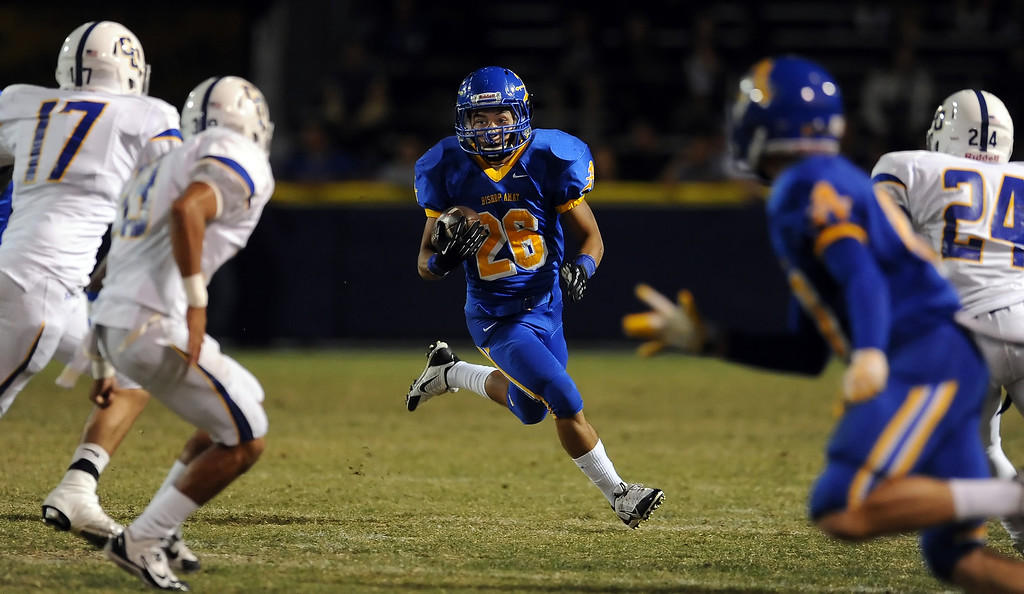 Description of . Bishop Amat's Gabriel Perez (26) runs for yardage against Charter Oak in the first half of a prep football game at Bishop Amat High School in La Puente, Calif. on Friday, Sept. 20, 2013.    (Photo by Keith Birmingham/Pasadena Star-News)