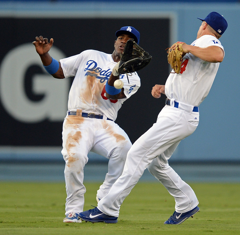 Description of . A miscommunication between Dodgers' Yasiel Puig #66 and Mark Ellis causes a Giants' Brandon Belt #9 flyable drop  during their game at Dodgers Stadium Saturday, September 14, 2013. (Photo by Hans Gutknecht/Los Angeles Daily News)