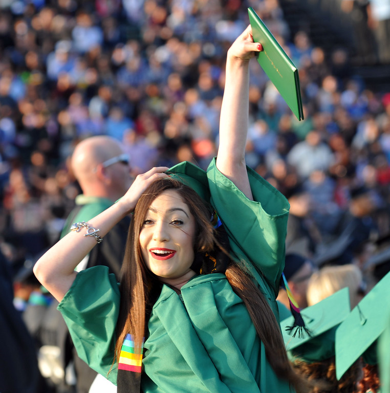 Description of . Gloria Welch shows her diploma on the field during the 53rd Commencement at Pioneer High School in Whittier on Wednesday June 12, 2013. (SGVN/Staff Photo by Keith Durflinger)