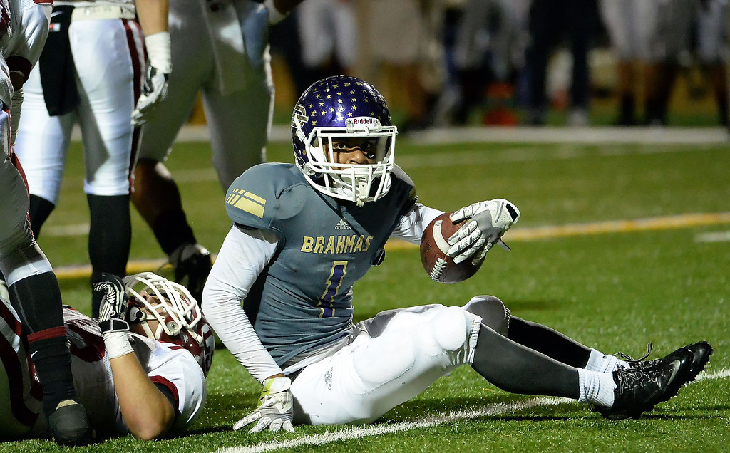 Description of . Diamond Bar's Tyler Brown (C) (1) after being tackled for a loss of yards by the La Serna defense in the first half of a CIF-SS playoff football game at Diamond Bar High School in Diamond Bar, Calif., on Friday, Nov. 22, 2013.   (Keith Birmingham Pasadena Star-News)