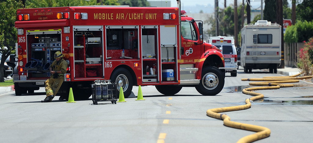 Description of . Los Angeles County Moblie Air/Light Unit helps in the battle of a 3-alarm fire at an abandoned warehouse near 9th Avenue and Clark Avenue on Tuesday, July 9, 2013 in City of Industry, Calif.  (Keith Birmingham/Pasadena Star-News)
