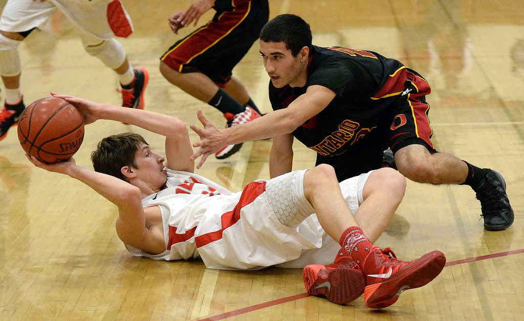 Description of . Pasadena's Edin Memisevic, left, scrambles for the ball with Ontario's Alfonso Bueno (23) in the first half of a prep playoff game at Pasadena High School in Pasadena, Calif., on Friday, Feb.21, 2014. (Keith Birmingham Pasadena Star-News)