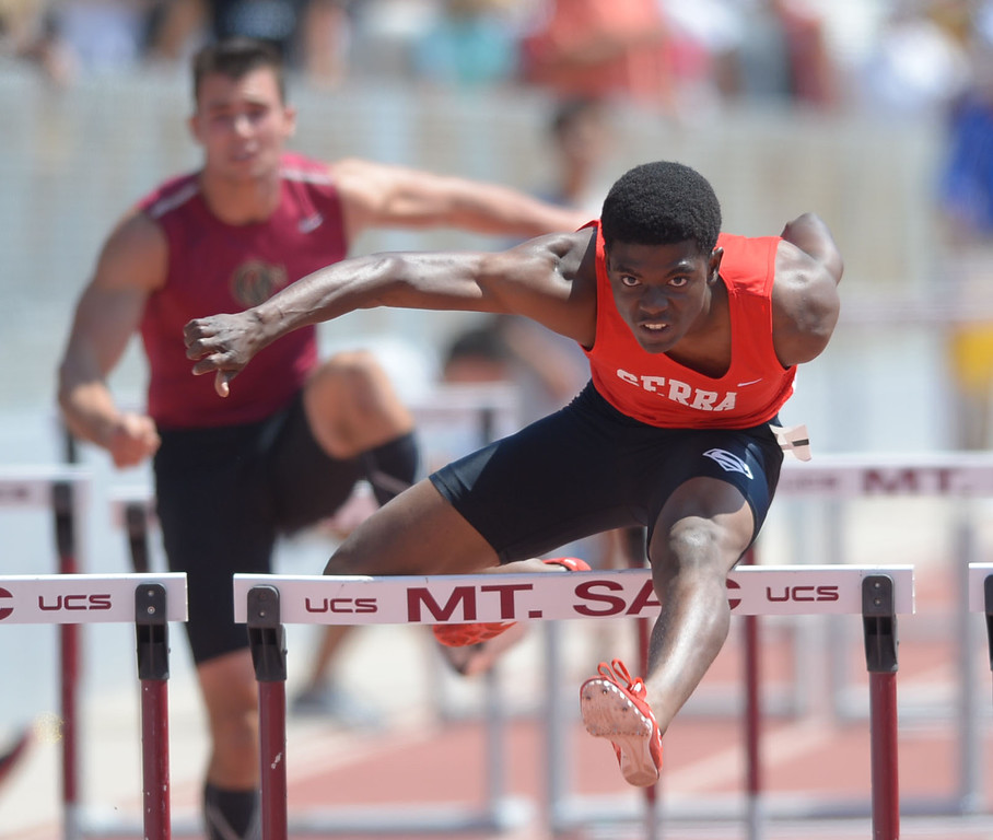 Description of . Serra's Lloyd Siscard wins the 110 meter Division 4 high hurdles race of the CIF Southern Section Track and Field Championships Saturday at Mt. SAC. He would later win the 300 hurdles race as well. 20130518 Photo by Steve McCrank / Staff Photographer