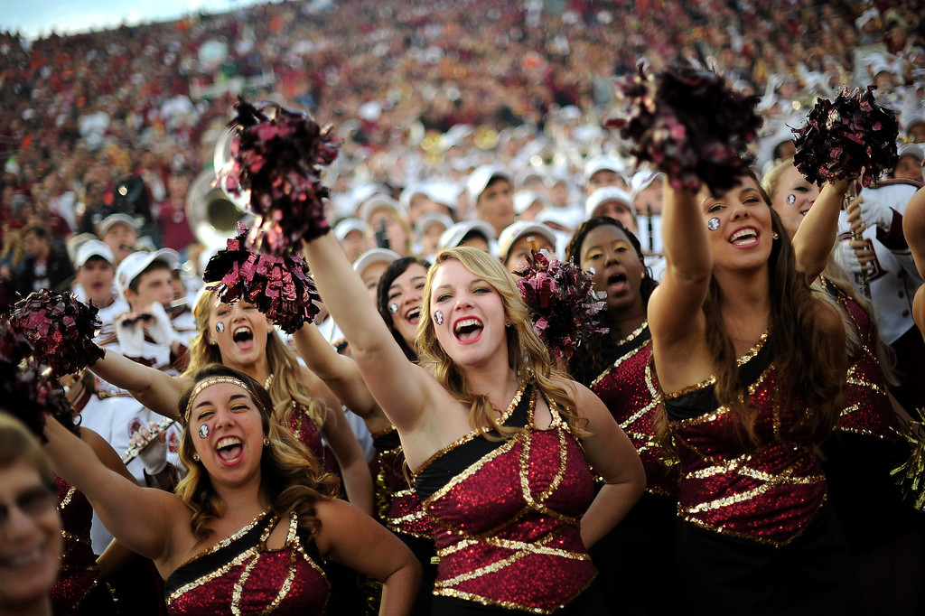 Description of . Florida State cheerleaders get the crowd going prior to the start of the 2014 Vizio BCS National Championship January 6, 2014 in Pasadena CA.(Andy Holzman/Los Angeles Daily News)