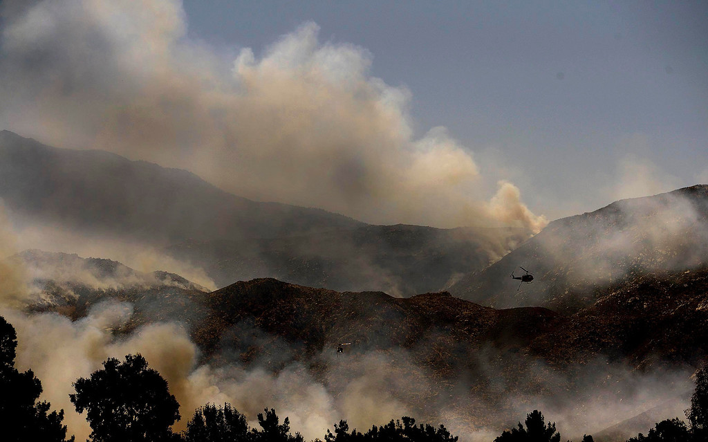 Description of . Copters make drops on the Silver Fire as seen from W. Lincoln Street as  it burns in the mountains south of Banning August 8, 2013.   GABRIEL LUIS ACOSTA/STAFF PHOTOGRAPHER.
