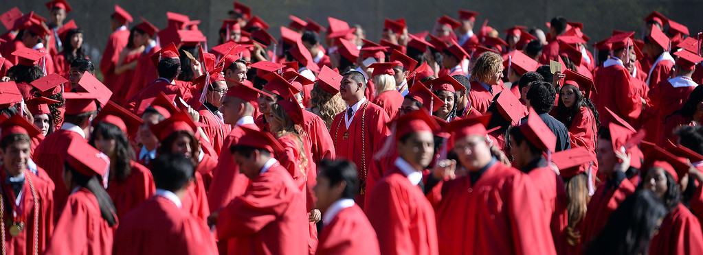 Description of . Students line-up prior to the Whittier High School graduation at Whittier College in Whittier, Calif., on Wednesday, June 4, 2014.  (Keith Birmingham/Pasadena Star-News)