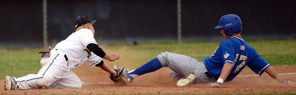 Description of . Northview third baseman Dustin Cabrera (9) tags out San Dimas' Jonathan Longtin (12) at third base in the fifth inning of a prep baseball game at Northview High School in Covina, Calif., on Wednesday, March 26, 2014. San Dimas won 2-0.