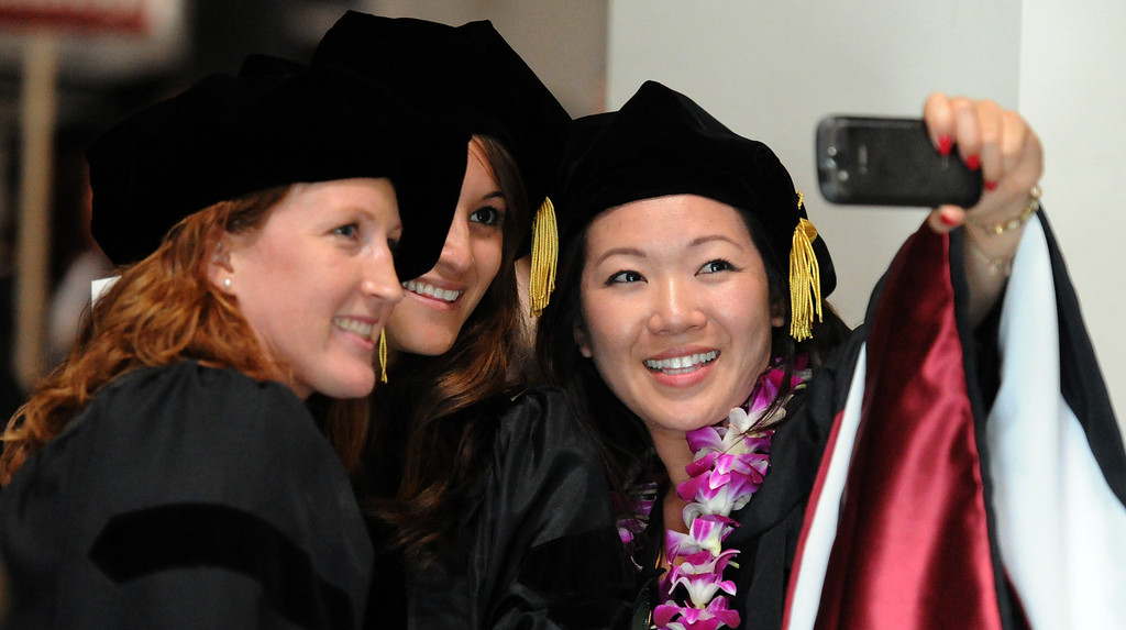 Description of . Clinical Psychology graduates Amy Sickel, left, Nicole Robello, center, with Jennifer Ku take a self portrait during the summer commencement ceremony at Azusa Pacific University on Friday, July 26, 2013 in Azusa, Calif.  (Keith Birmingham/Pasadena Star-News)