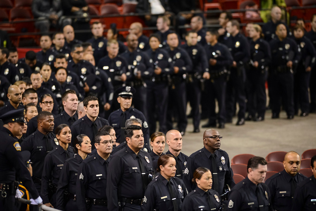 Description of . Hundreds of law enforcement officers filled the Los Angeles Sports arena for the memorial Tuesday, November 12, 2013.  A public memorial was held for Officer Hernandez who was killed at LAX when a gunman entered terminal 3 and opened fire with a semi-automatic rifle, Grigsby was wounded in the attack.  ( Photo by David Crane/Los Angeles Daily News )