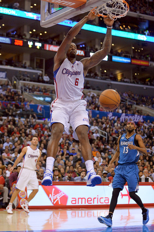Description of . Los Angeles Clippers' DeAndre Jordan dunks the ball against the Minnesota Timberwolves during the first half Monday, Nov. 11, 2013, in Los Angeles.(Andy Holzman/Los Angeles Daily News)